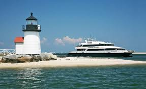 High Speed Steamship Next to Lighthouse