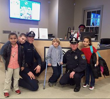 Police officers visiting children